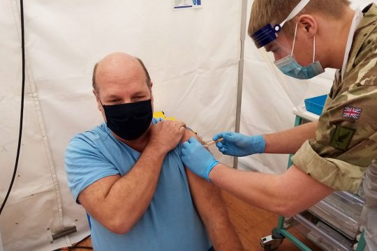 Philip Craddoc having his coronavirus vaccination at the Royal Cornwall Showground vaccination centre.